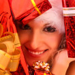 Young beautiful woman with presents — Stock Photo