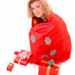Young woman with christmas bag isolated on white — Stock Photo #6813721
