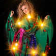 Young woman in New year and Christmas decoration on black backgr — Stock Photo