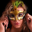 Beautiful woman in mask on black background — Stock Photo
