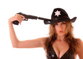 Beautiful sheriff woman with gun isolated on white — Stock Photo