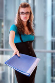 Young woman holding folder — Stock Photo