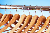 Wooden clothes hangers — Stock Photo