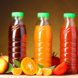 Different juices and fruits on wooden table on brown background — Stock Photo #6841985