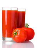 Tomato juice in glasses and tomato isolated on white — Stock Photo