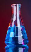 Test-tube on blue-red background — Stockfoto