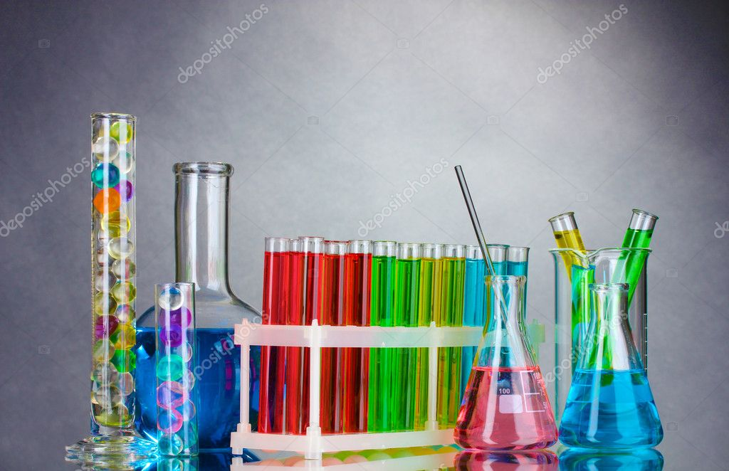 Test-tubes with liquid on gray background  Stock Photo #6840236