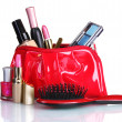 Beautiful red makeup bag and cosmetics isolated on white — Stock Photo #6883756