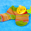 Bright baby socks and baby soothers - Stock Photo