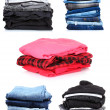 Collage of the piles of clothes - Stock Photo