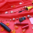 Many cosmetics on red background — Stock Photo #7286659