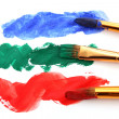 Paint brushes in color paint - Stock Photo