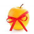 Yellow apple with ribbon isolated on the white background — Stock Photo
