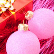 Christmas balls among silver glittering decoration — Stock Photo