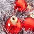 Red Christmas balls among silver glittering decoration — Stock Photo #7288059