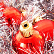 Christmas decoration among silver glittering background — Stock Photo