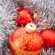 Stock Photo: Red Christmas balls among silver glittering decoration