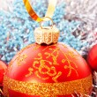 Red Christmas balls among silver glittering decoration — Stock Photo #7288085