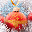 Red Christmas balls among silver glittering decoration — Stock Photo