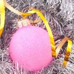 Christmas balls among silver glittering decoration — Stock Photo