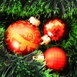 Red Christmas balls among green new year tree — Stock Photo #7288123