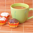 Coffee with milk color cup with cakes on bamboo straws backgroun — Stock Photo