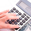 Calculator and womhand counts money — Stock Photo #7288605