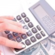 Calculator and womhand counts money — Stock Photo #7288607