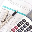 Calculate money  with the calculator — Stock Photo