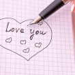 Hand with pen writing a love letter — Stock Photo