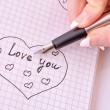 Hand with pen writing a love letter — Stock Photo #7288693