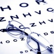 Glasses on test chart - Stockfoto