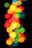 Color christmas lights on the tree — Stock Photo