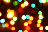 Color christmas lights background — Stock Photo