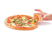 Tasty pizza and hand — Stock Photo