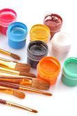 Gouache pots and brushes isolated on white — Stock Photo