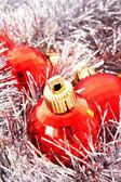 Christmas decoration among silver glittering background — Stock Photo