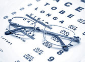 Close up of glasses and chart — Stock Photo