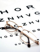 Glasses on test chart — Stock Photo