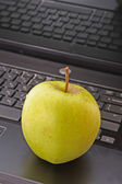 Abstract laptop with green apple — Stock fotografie