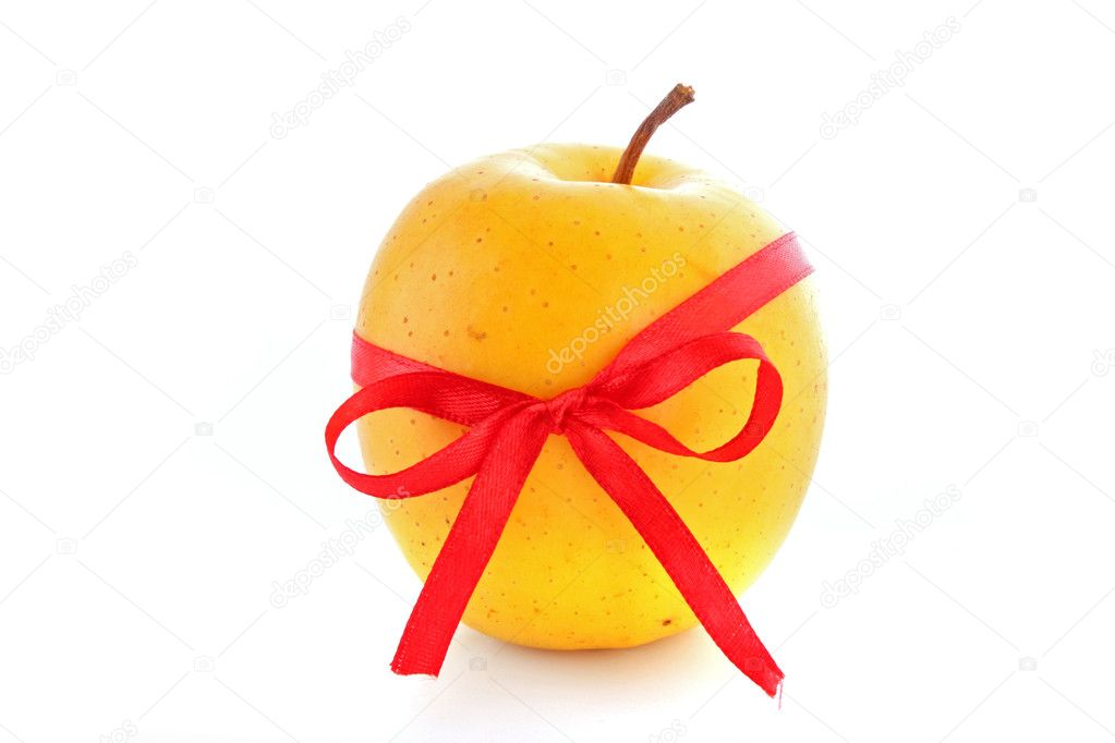 Yellow apple with ribbon isolated on the white background — Stock Photo #7287290