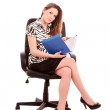Businesswoman in chair on white background — Stock Photo #7293546