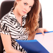 Businesswoman in chair on white background — Stock Photo