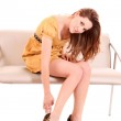 Fashion portrait of a beautiful young woman in leopard shoes — Stock Photo
