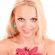 Beautiful young blonde woman with pink lily flower. Isolated on — Stock Photo