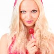 Beautiful blond girl in pink dress with candy on white — Stock Photo #7293689