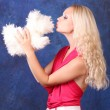 Beautiful blond girl in pink dress with small dog  on blue — Стоковая фотография