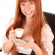Stock Photo: Smiling business woman drinking coffee isolated on white backgro