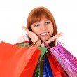 Beautiful, young, redhair woman with color shopping bags in her — Stock Photo