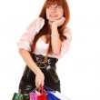 Beautiful, young, redhair woman with color shopping bags in her — Stock Photo #7294087